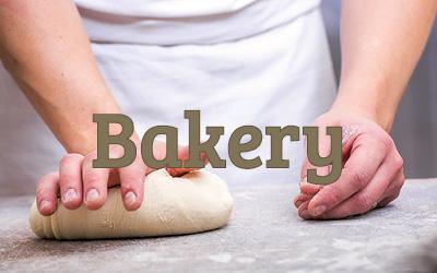 a baker kneading dough on a worktop